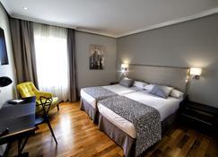 皇家公园酒店 - 雷阿尔城 - 睡房