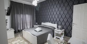 竞技场家庭旅馆 - 庞贝 - 睡房
