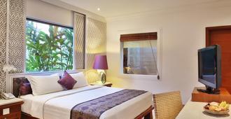 巴厘岛曼德拉海滩度假村 - 库塔 - 睡房