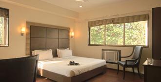 阿米戈酒店 - 孟买 - 睡房