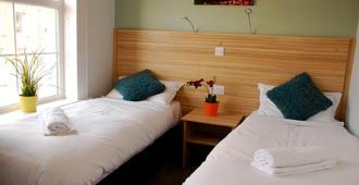 皇后植物园休憩酒店 - 贝尔法斯特 - 睡房