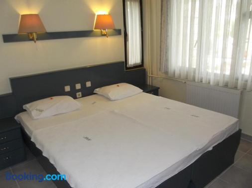 哈尔图酒店 - 帕莫卡莱 - 睡房
