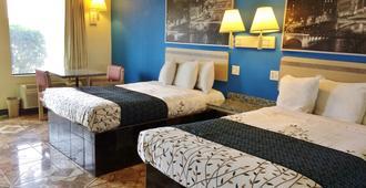 博蒙特美洲最佳价值客栈 - 博蒙特 - 睡房