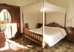 拉卡萨菲奥里塔公寓 - 诺托 - 睡房