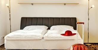 艾菲酒店 - 布尔诺 - 睡房