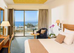 亚历山大海滩温泉酒店 - 亚历山德鲁波利斯 - 睡房
