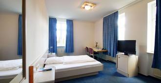 牛尔特斯豪斯高级酒店 - 斯图加特 - 睡房