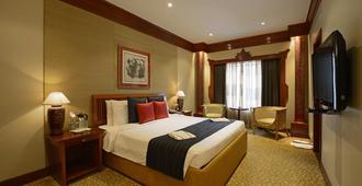 孟买阳光沙滩酒店 - 孟买 - 睡房