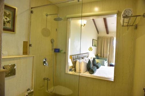 果阿金色郁金香酒店 - 坎多林 - 浴室