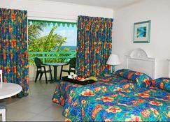 蓝兰花海滩酒店 - 布里奇敦 - 睡房
