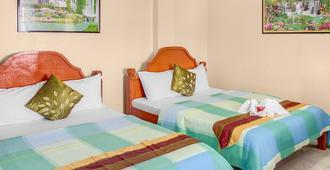蓝珊瑚海滩度假村 - 达安班塔延 - 睡房