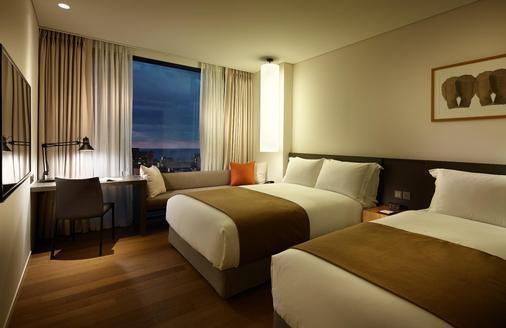 济州新罗舒泰酒店 - 济州 - 睡房