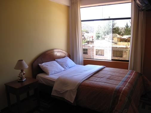 卡萨德玛玛库斯科雷科莱塔酒店 - 库斯科 - 睡房