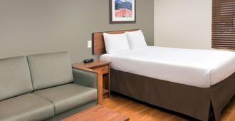 堪萨斯城南伍德斯普林套房酒店 - 堪萨斯城 - 睡房