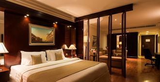 多哈贝斯特韦斯特尊贵酒店 - 多哈 - 睡房