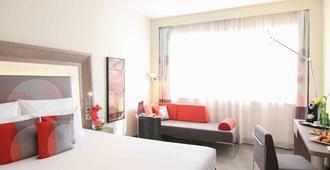 迪拜世贸中心诺富特酒店 - 迪拜 - 睡房