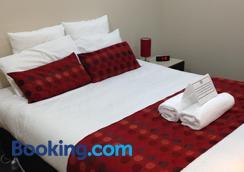 科摩多里根酒店 - 伦瑟斯顿 - 睡房