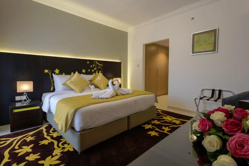 城市之旅尊贵公寓式酒店 - 迪拜 - 睡房