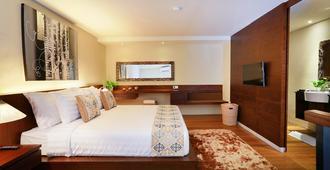 乌玛拉斯潘达瓦公寓式酒店 - 仓古 - 睡房
