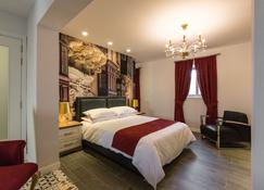 尚迪瓦勒特精品生活酒店 - 瓦莱塔 - 睡房