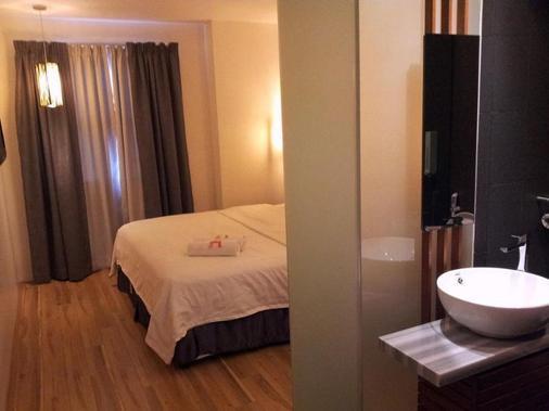 唐多普酒店 - 亚罗士打 - 睡房