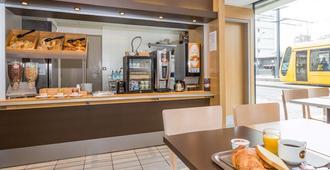 穆尔豪斯中心住宿加早餐酒店 - 米卢斯 - 自助餐