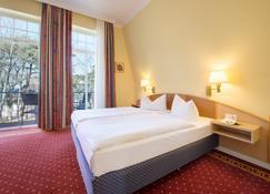 康泽尔花园公寓酒店别墅 - 屈赫隆斯博尔恩 - 睡房