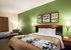 安眠套房酒店-机场 - 珍珠城 - 睡房