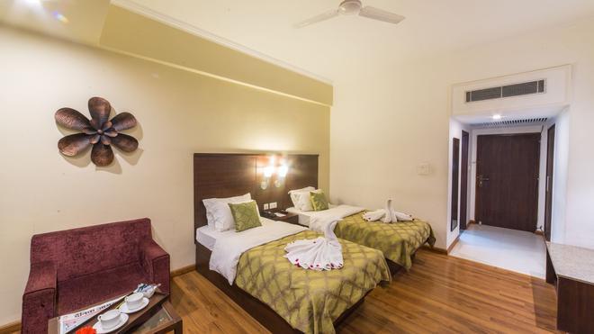 钻石大酒店 - 瓦拉纳西 - 睡房
