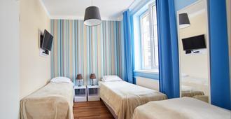 普瑞米安旅馆 - 克拉科夫 - 睡房