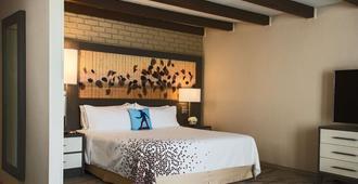 卡萨帕尔马斯酒店-温德姆商标系列 - 麦卡伦 - 睡房