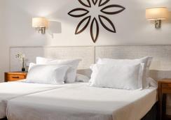 H10德芬旅馆-限大人 - 萨洛 - 睡房
