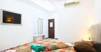 Habibah Syariah Hotel - 雅加达 - 睡房