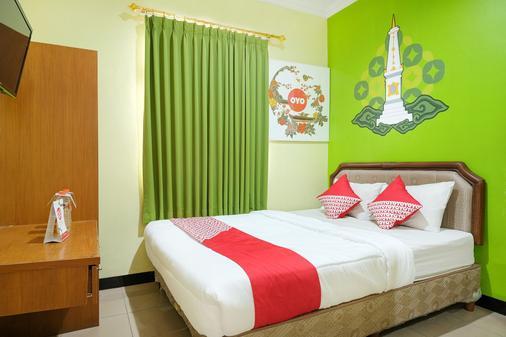 Oyo512达勒姆曼特利杰朗酒店 - 日惹 - 睡房