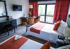 唐瓦斯科贝斯特韦斯特优质酒店 - 帕茨夸罗 - 睡房