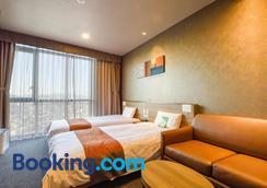 首尔江南多米酒店 - 首尔 - 睡房