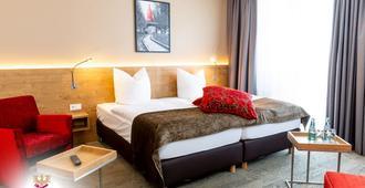 迈伽酒店 - 法兰克福 - 睡房