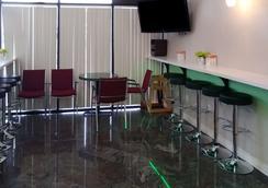 西能源走廊生态小屋套房酒店 - 休斯顿 - 餐馆