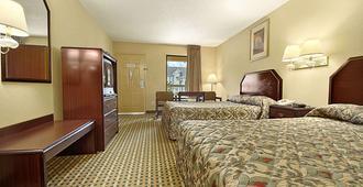 莫比尔提尔曼斯角速8汽车旅馆 - 莫比尔 - 睡房
