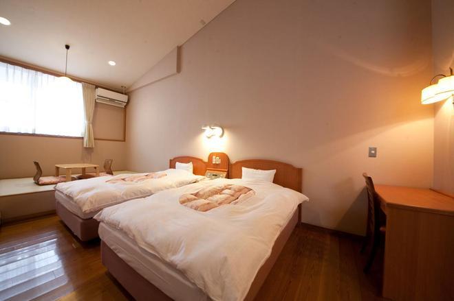大分汤布院温柔之乡酒店 - 由布市 - 睡房