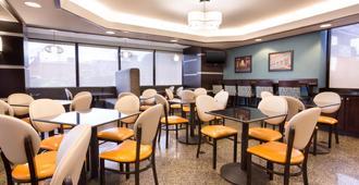 格林斯伯勒德鲁酒店及套房 - 格林斯伯勒 - 餐馆