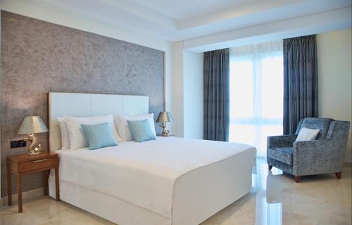 马斯喀特千年行政公寓酒店 - 马斯喀特 - 睡房