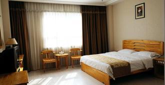 青岛利客来商务酒店 - 青岛 - 睡房