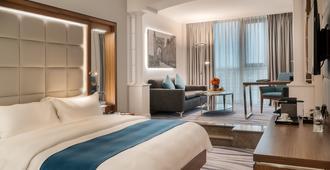 安曼华厦酒店及会议中心 - 安曼 - 睡房