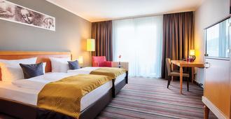 海德堡市中心莱昂纳多酒店 - 海德堡 - 睡房