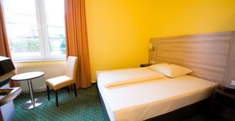 幻境酒店 - 杜伊斯堡 - 睡房