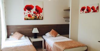 阿巴特斯加亚城市舒适酒店 - 莫斯科 - 睡房