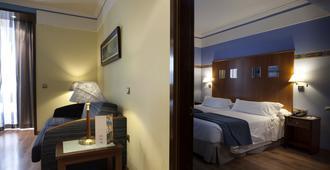 格兰大道44号套房酒店 - 格拉纳达 - 睡房