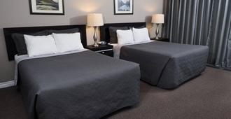 阿姆巴萨德汽车旅馆 - 苏圣玛丽 - 睡房