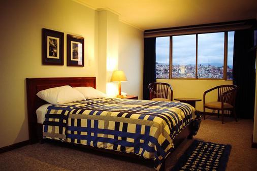 总统酒店 - 昆卡 - 睡房